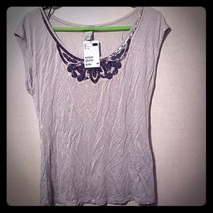 Grey stretchy shirt with beaded detail